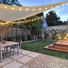 West Hollywood back yard Redwood platform deck, gravel / square paver patio, sail shade, string lights & landscape design. | Yelp