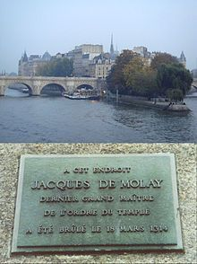 Marker at the site of De Molay's execution in Paris. (Translation: At this location, Jacques de Molay, last Grand Master of the Knights Templar, was burned on 18 March 1314), located by the stairs from the Pont-Neuf bridge. The top half of this photo shows the part of the island where the executions took place. The lower half shows the plaque, which is on one of the pillars of the bridge, behind the trees.