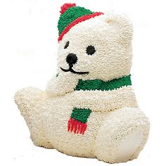 A Christmas Bear Cake is a cute critter appropriate for a wintertime dinner or birthday. Wilton 3-D cake pans make stand-up cakes like this easy to bake and decorate using just basic techniques like stars and dots.