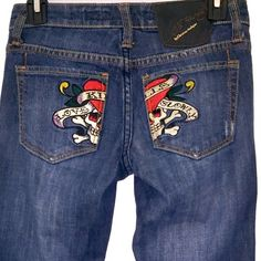 "Ed Hardy Jeans Ed Hardy ""Love Kills Slowly"" Jeansin size 24 have never been worn!  These dark wash, straight leg jeans are in BRAND NEW condition. They feature the Ed Hardy skull and heart patch over the back pockets. Ed Hardy Jeans Straight Leg"