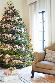 Large Christmas tree decorated with pink roses