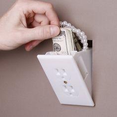 A hidden diversion safe that's made out of a regular plug outlet. This wall socket safe looks just like the rest of the plugs that are already installed in your home. Except this one can hide money, jewelry, or other small valuables that you don't want a thief to find.