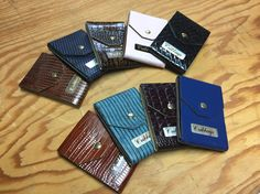 Different coloured leather cribbage boards