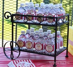 Baby Shower Water Bottle Display...Remove Original Water Bottle Label...Print Out Labels Or Use Scrap Book Paper To Make New Bright Labels...Cut To Size & Glue On Small Water Bottles...