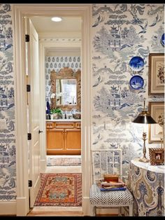 Beautiful wallpaper in this elegant - but not too fussy - dressing room.