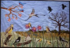 """8 Birds of the North American Grasslands. An original quilted wallhanging designed by Debbie Lange and Eric Lange. Features the eastern bluebird (male and female), western meadowlark, lark bunting (male and female), American goldfinch (male and female), dickcissel, scissor-tailed flycatcher, bobolink, and American crow.  Finished size 43"""" by 30."""" email to: DebbieLangeQuilting@gmail.com Facebook: Debbie Lange Quilting www.DebbieLangeQuilting.blogspot.com Pinterest: Debbie Lange Quilting"""