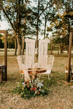 Sweetheart Reception table with boho vibe. Cool outdoor reception featured garden chairs, hanging macrame backdrop and muted wedding flowers | Boston Georgia wedding florist | Wedding planner Georgia | Thomasville florist  Thomasville Wedding Tallahassee Wedding Vendors