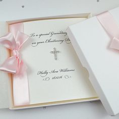 """A beautiful personalised Christening / Baptism / Holy Communion card with dazzling diamonte cross and tiny sparkling Swarovski crystals. A lovely keepsake to keep for years to come.  PERSONALISATION  Enter your invitation text, as you would like it to appear, in the """"NOTES TO SELLER"""" box.  PRODUCT DETAILS  :: Printed on diamond white linen embossed 300gsm board :: Available with a white, blue or pink ribbon :: Supplied with white pearlescent envelope :: Upgrade to tissue lined ribbo..."""