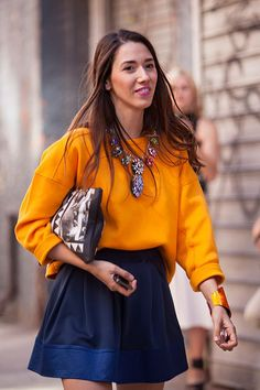Gorgeous orange top paired with blue skirt and colorful statement necklace.New…