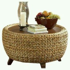 Hmmm I wonder if I could make something like this. Maybe tires wrapped with rope and add feet. It would be heavy.but hmmm! Tire Table, Wicker Table, Tire Ottoman, Tire Craft, Drum Coffee Table, Deco Zen, Tire Furniture, House Furniture, Tyres Recycle