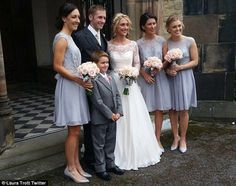 Pictured: Newlyweds Kenny and Trott pose for a photo after their ceremony yesterday