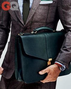 Briefcase, $950, by LotuffSuit, $3,495, by Isaia Watch by Omega.