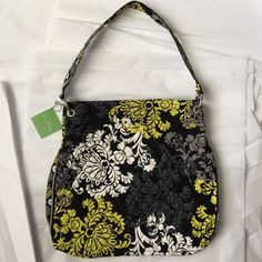 Vera Bradley Tote!NWT Vera Bradley Tote! New with tags! Baroque is the pattern name! Black with yellow, White and Gray colors! 13.5x14.5 inches! Handle drop 10.5 inches. Great to grab and go! Vera Bradley Bags Totes