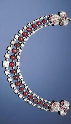 An art deco ruby and diamond festoon necklace, circa 1935.