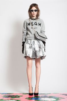 Karen Walker...love the gray sweatshirt with the skirt.