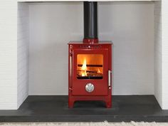 Mendip 5 Enamel Wood Burning Stove Multi-Fuel Stove - better with a silver flue and in blue not red Cabin Fireplace, Inglenook Fireplace, Stove Fireplace, Living Room With Fireplace, Wood Pellet Stoves, Self Build Houses, Lounge Lighting, Multi Fuel Stove, Wood Pellets