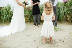Thea and Jesse's Oregon Beachside Elopement with flower girl in lace dress in the sand by Victoria Greener Photography