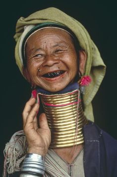 A woman models her brass neck rings, Loikaw, Burma, 1994, photograph by Steve McCurry.