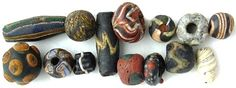 Eastern Mediterranean, 14 Glass Beads, Greek - Islamic, c. 330 B.C. - 1400 A.D.