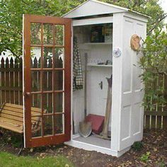 "a grand idea! constructing a garden shed out of old doors... love the ""front"" door with glass panes"