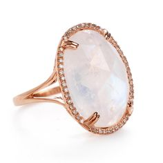 GETANA ROSE GOLD MOONSTONE RING. Featuring a radiant, oval-shaped moonstone gem that reflects a rainbow of colors, this ring is finished with rose gold and micropave diamond accents.   Diamonds:  .20 total weight Stones:  Moonstone Metals:  18k Rose Gold Currently available in a size 7.  See customer care for sizing information. Made in USA.   Item number:  202-01104 $1200.00.
