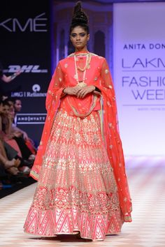 This elegant hot pink lehenga is one of Anita Dongre's most desirred pieces from her latest bridal collection. Covered with intricate gota pati embroidery and hand work, this lehenga is a piece of art. The lehenga can be paired with a hot pink plain raw silk bandi or choli with gota pati embroidery and a delicate net dupatta with embroidery.