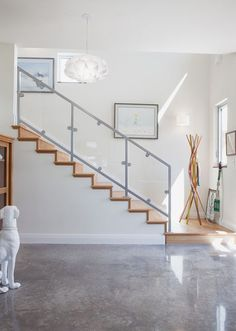 Modern entry by Kailey J. Flynn Photography. I love the polished concrete floors.