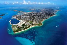 Key West! See ya real soon! ☀...Key West, Florida...this is an incredible place to fly over in a little puddle jumper...seeing straight through the water the whole way....