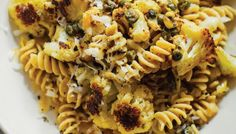 Cauliflower is roasted until nicely browned, then tossed with garlic, pine nuts, capers, a jolt of lemon zest and freshly cooked pasta. Finish with shavings of Parmigiano-Reggiano and another layer of lemon and grab a fork