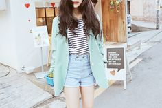 A cute casual outfit with the denim shorts, black and white striped shirt and the mint green jacket.