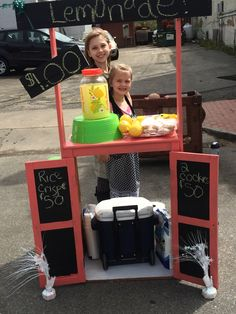 Lemonade stand made out of an old dresser and a pallet! Quick simple and cheap.  These girls set it up to rises money for the library.
