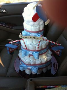 Precious Cargo diaper cake for airplane themed shower. Terrible pic! Cloud on top with cotton balls, wooden planes flying off striped straws