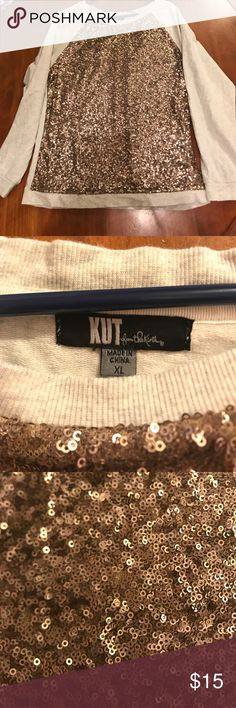 Sequin Sweatshirt Kut from the Kloth Copper colored sequin sweatshirt. Super soft sweatshirt material with mesh that blocks the sequins from being itchy. One tiny spot where sequins are missing, but you can't see it unless you're looking for it. XL  but fits more like a Medium or Large. 19.5 inches arm pit to arm pit when laying flat. Love wearing it, now too big on me. Kut from the Kloth Sweaters Crew & Scoop Necks