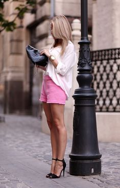 loose blouse, colored shorts, black heels <3