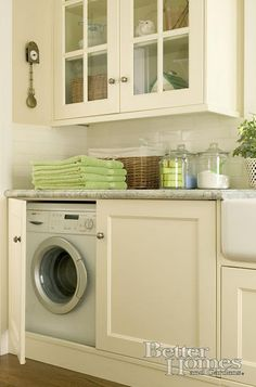 The antique white cabinets makes me want to actually do laundry! I love this hidden washer and dryer.