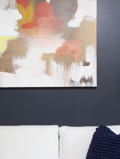 Set the Scheme - A Painter's DIY Small Condo Design on HGTV - The walls were painted a dark blue tone from Benjamin Moore called Black Horizon.