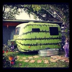 painting on tiny trailers | Now this can actually hide in your garden.