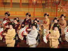 geisha-licious:  Kyo Odori: Miyagawa Ondo dance by MANATORA-PHOTO on Flickr maiko Fumitama (red), geiko Kikuno, maiko Fukuhina (plum), Fukukimi (purple), geiko Komomo, maiko Fukuyu (blue), Toshichika (yellow), Fukuhiro (green), geiko Fukuteru and maiko Chikayuki (pink)