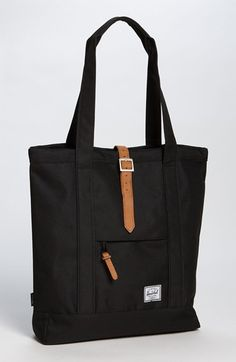 Free shipping and returns on Herschel Supply Co. 'Market' Tote at Nordstrom.com. Signature striped fabric lines a classically designed tote outfitted with padded carrying handles and zip and interior sleeve pockets for easy organization. Tuck your laptop or notebook into the back wall pocket for easy transport.