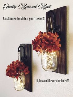 This is a beautiful set of 2 mason jar wall sconces. It includes two sconces, hanging mason jars and flowers. The sconce measures 14 tall and 5 wide. Jars are pint size. FLOWERS AND LIGHTS BATTERY OPERATED FAIRY LIGHTS INCLUDED!! Scroll through the listing to see your flower