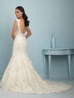 Allure Bridals 9220 | Floral appliques add dimension to our elegant fit-and-flare gown.