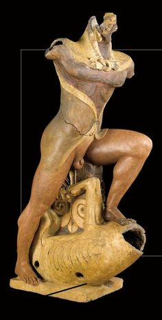 Etruscans - terracotta statue depicting Heracles, from the temple of Portonaccio in Veio (Rome). The late sixth century. B.C. Rome, National Etruscan Museum of Villa Giulia.