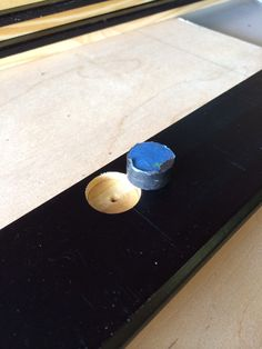 """Placing magnets into rail (glued). Big gotcha here as orientation matters. Blue taped magnet represents the orientation of the paired magnet placed into the dry erase board. I didn't want the boards to be """"propelled"""" from the wall into the work space (DT-Penalty ~ inside joke)"""