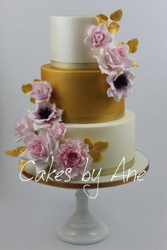 A Wedding Cake, dressed with flowers.
