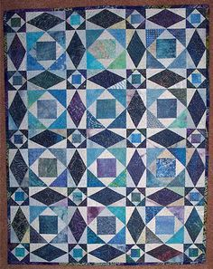 Storm at Sea quilt with scrappy blues.