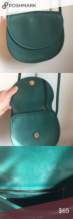 """Vintage Coach Casey Bag RARE Style Number: 9923 Handcrafted in the United States Beautiful quality green leather  Hidden magnetic snap closure on the flap closure of the bag and the internal flap of the bag is leather lined.  The interior is a spacious open compartment with a zipped pocket on the backside of the interior.  The bag is a cross-body with a 26"""" strap drop. This allows for the bag to be carried on the shoulder or across your body to allow for hands free movement. Coach Bags…"""