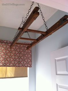 laundry room ladder drying rack, laundry room mud room, repurposing upcycling, Two toggle ceiling hooks on swivels attach the chain to the ceiling Old Ladder, Vintage Ladder, Hanging Ladder, Wooden Ladder, Laundry Room Drying Rack, Ceiling Hooks, Washing Windows, Just In Case, Home Projects