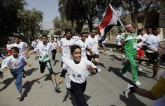 Runners break away at the sound of the gun at the start of a marathon for the Arab League Summit on Abu Nawas street in central Baghdad, Iraq, Sunday, March 25, 2012. Iraq is preparing to host a meeting of the Arab world's top leaders. (AP Photo/Khalid Mohammed)