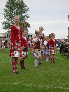Third from left - kilt with brick red vest, gold trim and white socks #Young #Other #Tartan