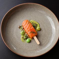 #Repost @piersdawson Salmon Lolly-Pop... Citrus and star anise cured and raw salmon lolly-pop avocado purée wasabi aioli salmon keta puffed wild rice and wasabi pea granola dill... Fish course from Friday's Charlie's Kitchen. On a @artistjodidawson plate